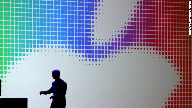 Apple CEO Tim Cook leaves the stage after introducing iOS 8 at the company's Worldwide Developers Conference in June.
