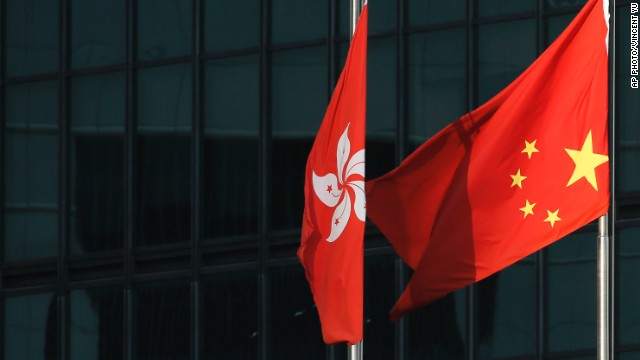 Protesters turn the Chinese flag upside-down on September 29 outside a commercial building near the main Occupy Central protest area in Hong Kong.