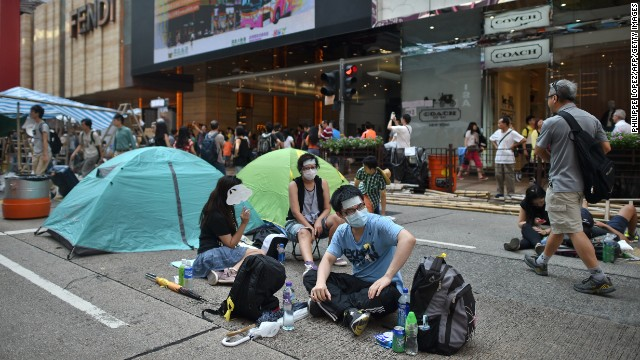 Protesters camp out in a street in Hong Kong on Wednesday, October 1.