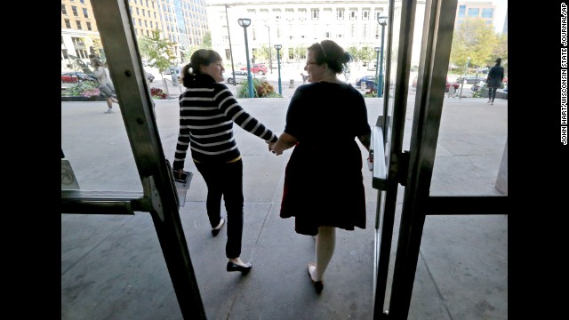 Abbi Huber, left, and Talia Frolkis exit the City County Building in Madison, Wisconsin, after applying for a marriage license on October 6.