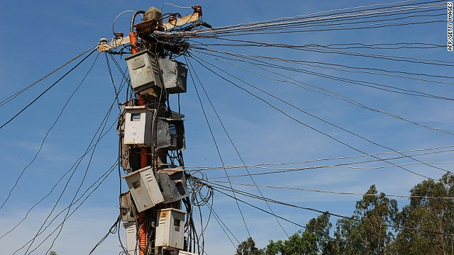 An ad hoc collection of electricity meters are barnacled onto a power pole in India. While smart meters have been in use in the United States and Europe for more than a decade, in markets such as Africa they are set to encourage much-needed investment in the sector.