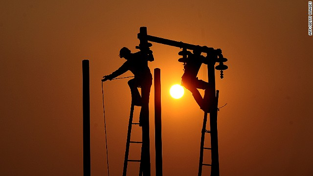 "Workmen maintain energy infrastructure in India ahead of a holy festival near the Ganges. ""The first major problem of energy in emerging markets is getting access to it in the first place, the second problem is that when there is access it gets stolen,"" says Alain Ballock."