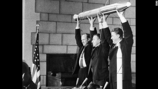 A model of Explorer 1, held by JPL's Director William Pickering, scientist James Van Allen and rocket pioneer Wernher von Braun (from left to right). The team was gathered at a news conference at the National Academy of Sciences in Washington to announce the satellite's successful launch. America's first satellite had been launched a few hours before, on January 31, 1958.