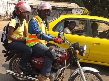 Harris Kollie (pictured on his motorbike) has been driving customers around Monrovia since 2005.