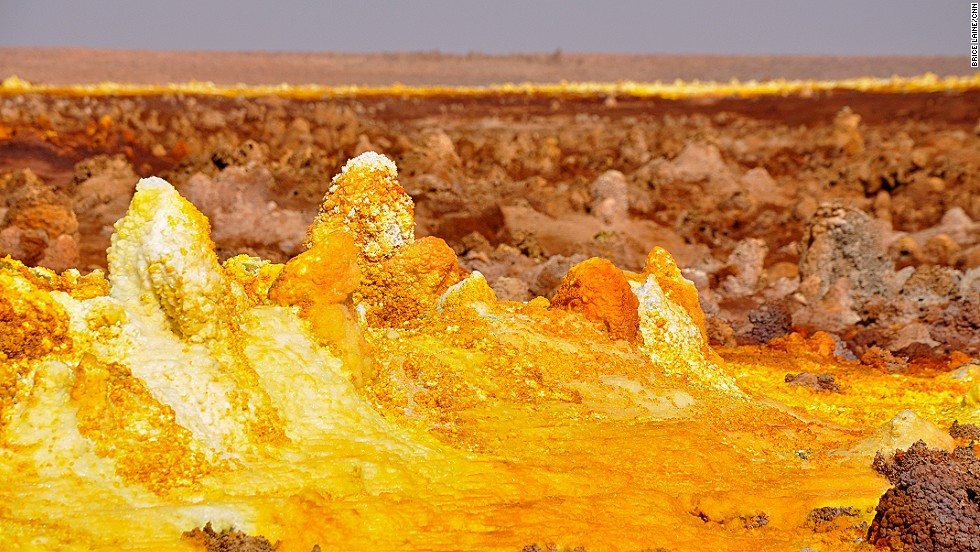 The Danakil Depression desert basin reaches up to 125 meters below sea level due to the tectonic activity caused by plate movements in the region, and is home to fields of sulphurous hot spirings like this one.