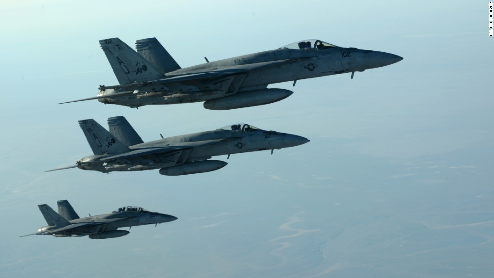 "In this photo released by the U.S. Air Force, fighter jets fly over northern Iraq as part of coalition airstrikes in Syria on Tuesday, September 23. The United States and several Arab nations <a href=""http://www.cnn.com/2014/09/23/world/meast/isis-airstrikes/index.html"">have started bombing ISIS targets</a> in Syria to take out the militant group's ability to command, train and resupply its fighters."