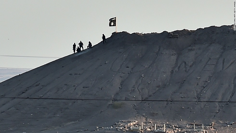 Alleged ISIS militants mount subsequent to an ISIS dwindle atop a mountain in Kobani on Monday, Oct 6.