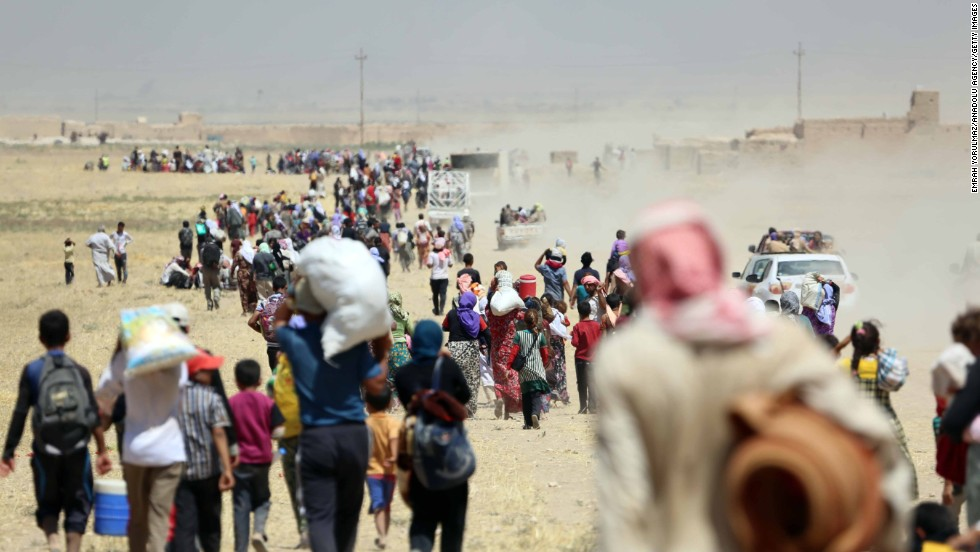 Thousands of Yazidis are escorted to reserve by Kurdish Peshmerga army and a Peoples Protection Unit in Mosul on Saturday, Aug 9.