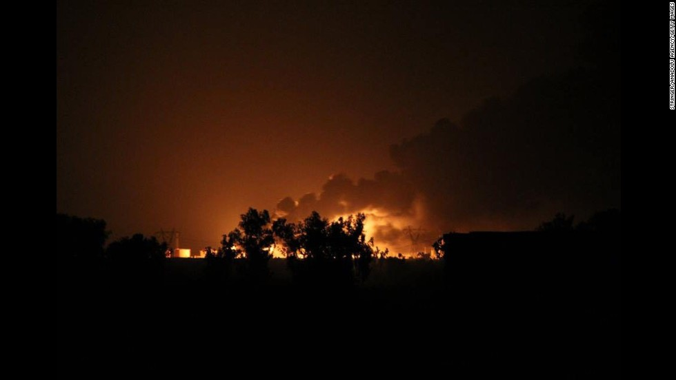 A Baiji oil refinery browns after an purported ISIS dispute in northern Selahaddin, Iraq, on Thursday, Jul 31.