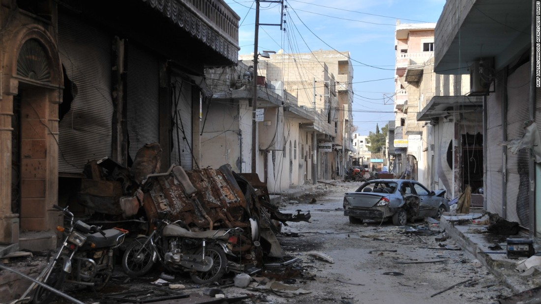 Collapsed buildings are seen in Kobani on Jan 27 after Kurdish army took control of a city from ISIS.