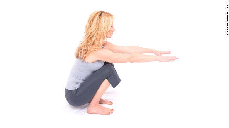 Functional squat: Lengthens spine, especially low back and realigns the pelvis and hips.<br />