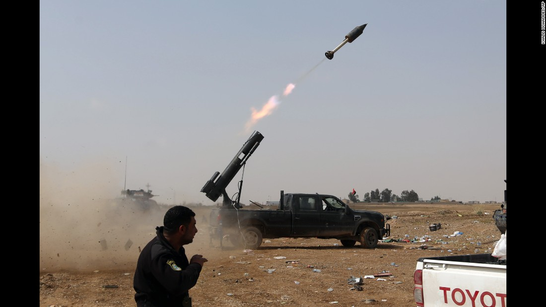 Iraqi confidence army launch a rocket opposite ISIS positions in Tikrit on Monday, Mar 30.