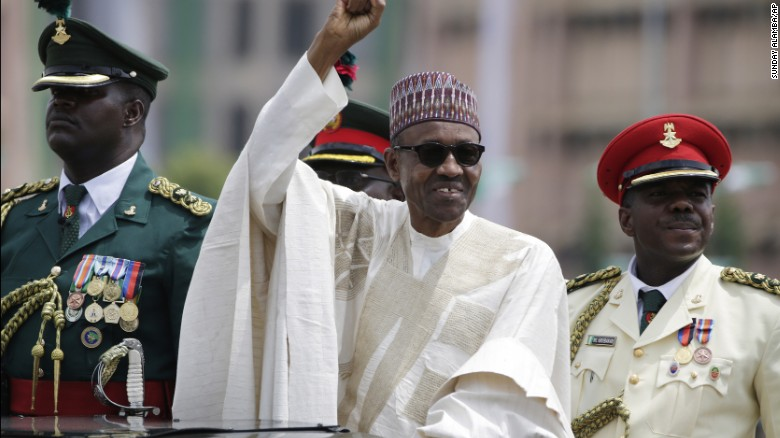"""New Nigerian President Muhammadu Buhari salutes supporters during his inauguration in Abuja, Nigeria, on Friday, May 29. The ceremony marked <a href=""""http://www.cnn.com/2015/05/29/africa/nigeria-buhari-sworn-in/"""" target=""""_blank"""">the first peaceful transfer of power between rival parties</a> in the African nation."""