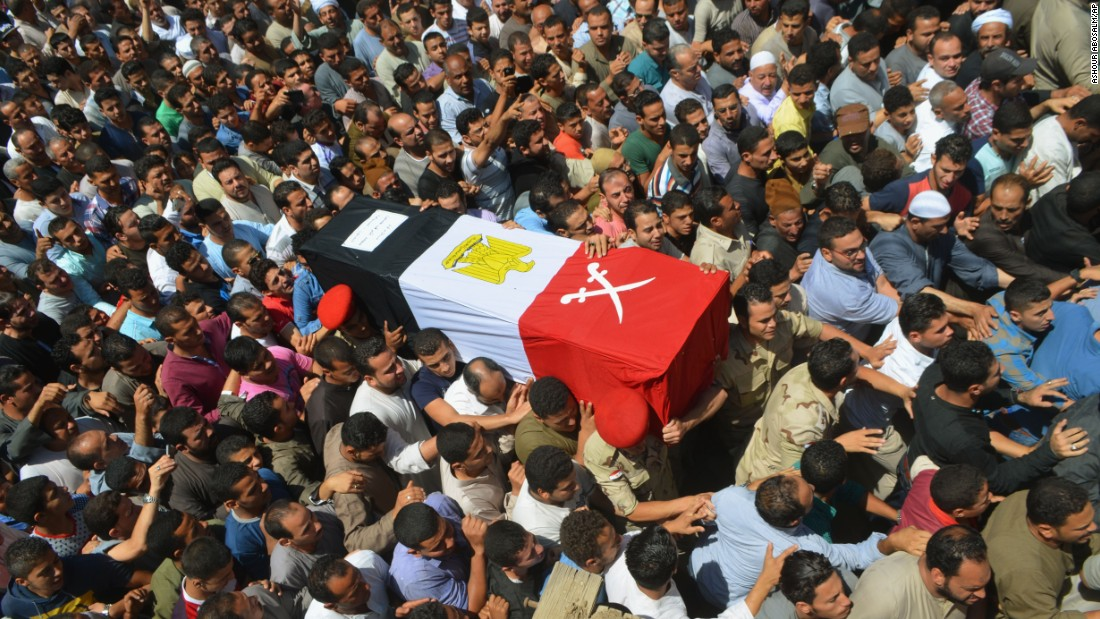 People in Ashmoun, Egypt, lift a coffin for 1st Lt. Mohammed Ashraf, who was killed when a ISIS belligerent organisation lt;a href=quot;http://www.cnn.com/2015/07/02/world/isis-egypt-expanding-reach/index.htmlquot; target=quot;_blankquot;gt;attacked Egyptian infantry checkpointslt;/agt; on Wednesday, Jul 1. At slightest 17 soldiers were reportedly killed, and 30 were injured.