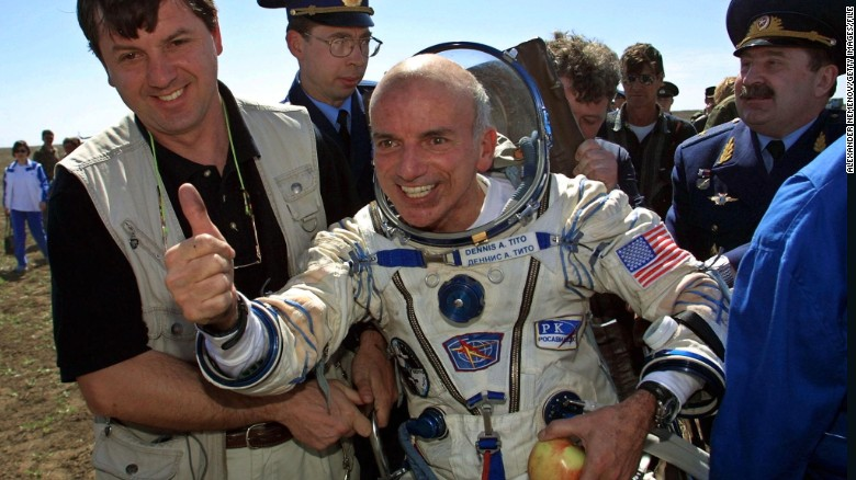 The world's first space tourist, Dennis Tito, celebrates after landing near the Kazakh town of Arkalyk in 2001.