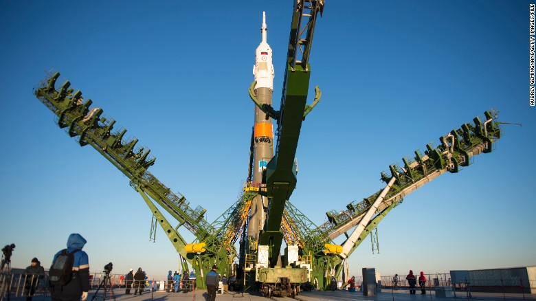 The gantry arms close around the Soyuz TMA-15M spacecraft to secure the rocket before launch.