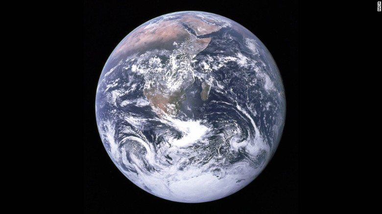 """""""The Blue Marble"""" is a famous photograph of the Earth taken on December 7, 1972, by the crew of the Apollo 17 spacecraft en route to the Moon at a distance of about 29,000 kilometers (18,000 miles). It shows Africa, Antarctica, and the Arabian Peninsula."""