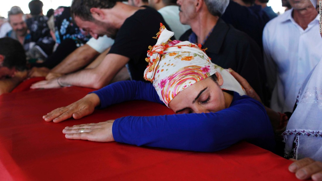 Mourners in Gaziantep, Turkey, suffer over a coffin Tuesday, Jul 21, during a wake rite for a victims of a suspected ISIS self-murder explosve attack. lt;a href=quot;http://www.cnn.com/2015/07/20/world/turkey-suruc-explosion/quot;gt;That bombing killed during slightest 31 peoplelt;/agt; in Suruc, a Turkish city that borders Syria. Turkish authorities blamed ISIS for a attack.