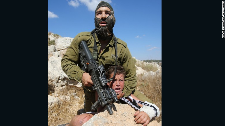 """Bassem Tamimi, the boy's father, told CNN that he was present at the time. """"This is very difficult for any father or mother to see their son or daughter in that way, being violently attacked,"""" said Tamimi."""