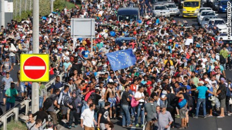 http://i2.cdn.turner.com/cnnnext/dam/assets/150904172147-migrants-walk-from-budapest-large-169.jpg