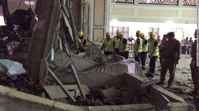 Civil Defense personnel inspect the damage at the mosque.