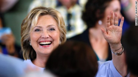 Democratic presidential candidate Hillary Clinton waves to the audience at a campaign organizing ...