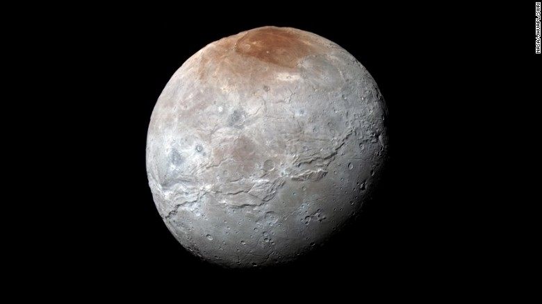 "<a href=""https://www.nasa.gov/feature/pluto-s-big-moon-charon-reveals-a-colorful-and-violent-history"" target=""_blank"">Pluto's largest moon, Charon</a>, in seen in enhanced color in this image taken by NASA's New Horizons spacecraft. The space probe took the image just before it made its closest approach on July 14, 2015. The image combines blue, red and infrared images to best highlight the moon's surface features. Charon is 754 miles (1,214 kilometers) across. The image was released on October 1, 2015."