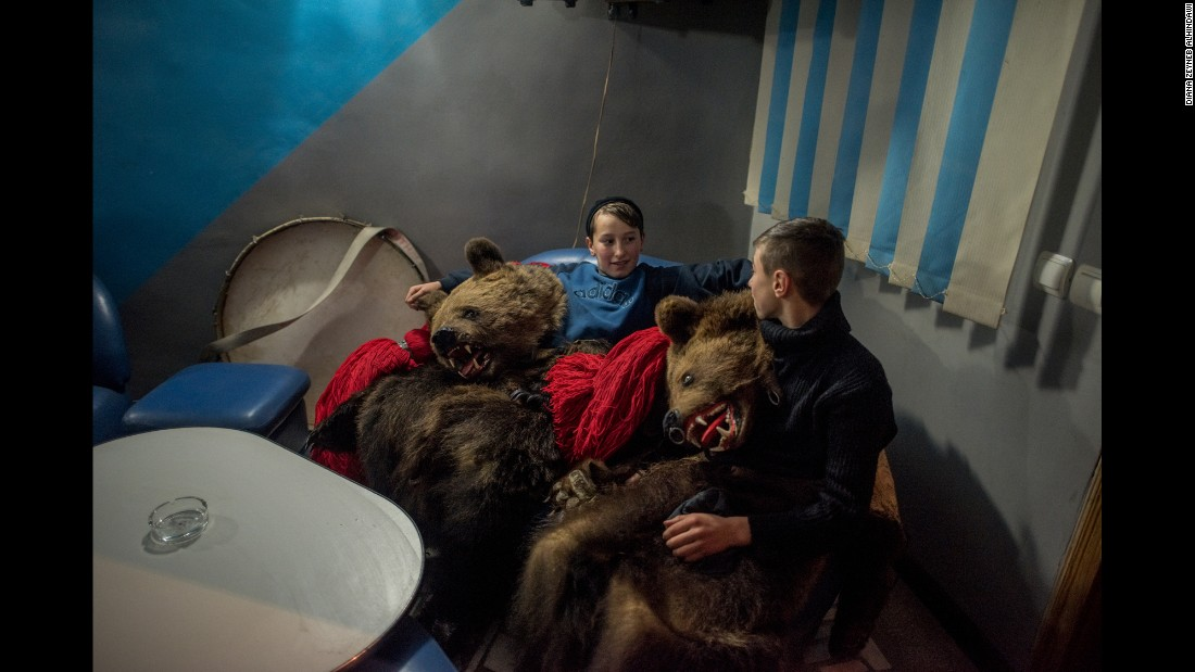 Between visits to private homes where they've been invited to perform, a troupe of bears stops at a bar.