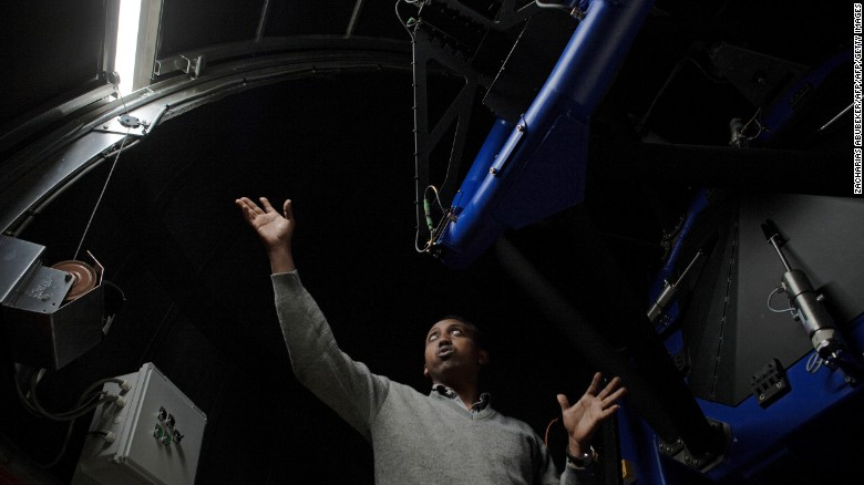 Ghion Ashenafi, an electrical engineer at the Entoto Observatory and Research Center, inside one of the center's telescopes.