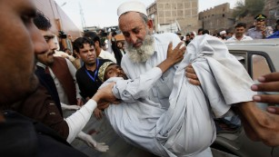 A man is carried to a hospital in Peshawar, Pakistan, on Monday, October 26. A magnitude-7.5 earthquake struck near Jarm, Afghanistan, along the Afghanistan-Pakistan border.