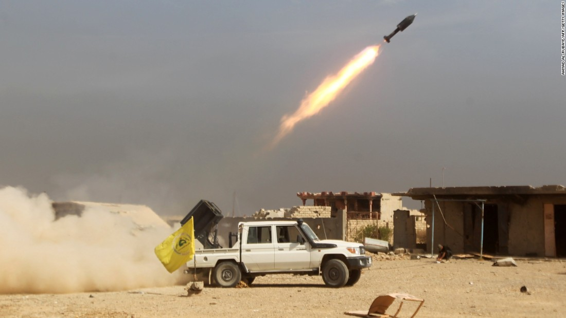 Shiite fighters, fighting alongside Iraqi supervision forces, glow a rocket during ISIS militants as they allege toward a core of Baiji, Iraq, on Monday, Oct 19.