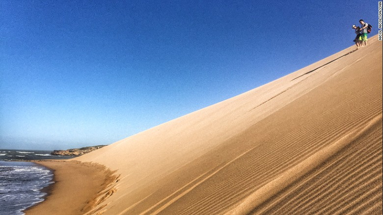 """Punta Gallinas has an """"end of the earth"""" feel, helped by the 200-foot-high Taroa Dunes, which tumble straight down into the tumultuous Caribbean."""