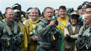 """President George W. Bush displayed the """"git 'er done"""" attitude on an aircraft carrier in 2003, where he declared """"Mission Accomplished"""" in Iraq."""
