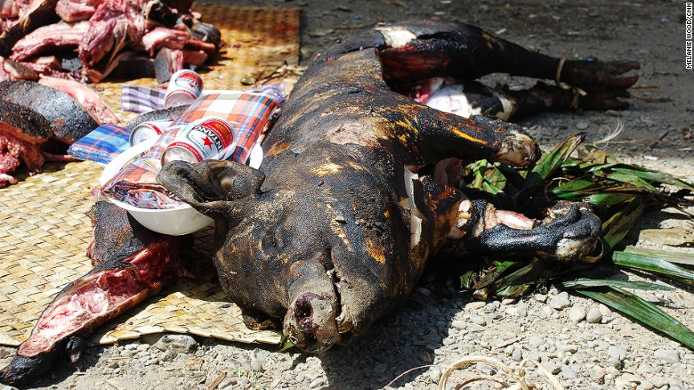 He'll look better in a few hours. Babi guling, or roast suckling pig, is one reason to visit Bali.