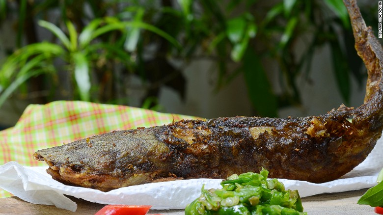 Fried catfish is usually served with rice and red and green sambal.
