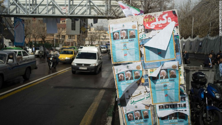 Campaign posters covered all kinds of surfaces in Tehran on Wednesday, the last day of campaigning. Some see the parliamentary vote as a referendum on President Hassan Rouhani and the nuclear deal he spearheaded.