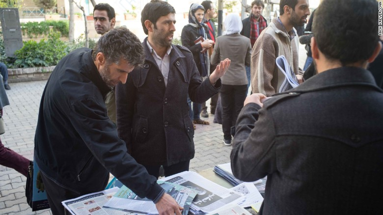 Conservatives -- like these men discussing politics outside an event in Tehran -- also seem energized ahead of the upcoming election. They have expressed concerns about undue influence by the West, specifically the United States and Britain.
