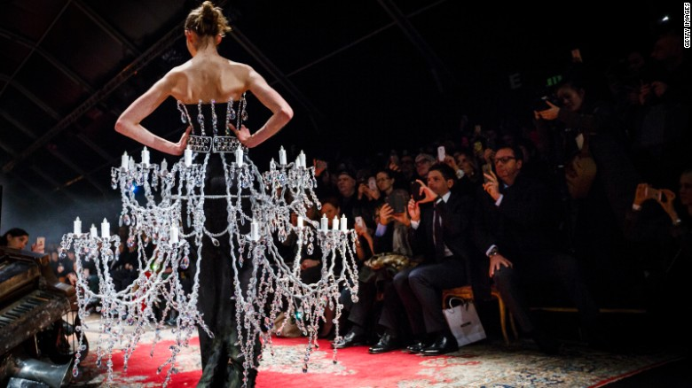Moschino's creative director Jeremy Scott is known for his elaborate designs. This chandelier gown featured thousands of Swarovski crystals.