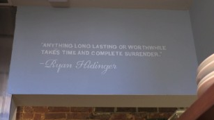 A quote from Ryan Hidinger on the wall at the Staplehouse restaurant.