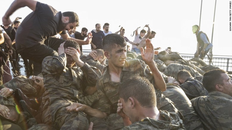 Soliders involved in the coup attempt surrender on  Bosphorus Bridge on Saturday.