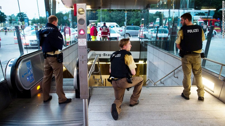 Police secure the entrance to a nearby transit station.