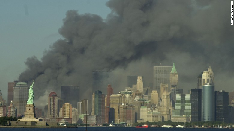 Thick smoke rises over the New York City skyline after the World Trade Center towers were downed by terrorists on September 11, 2001. Nineteen men hijacked four passenger planes that day in an attack orchestrated by al Qaeda leader Osama bin Laden. Two of the planes were intentionally crashed into the two World Trade Center towers. Another crashed into the Pentagon. The fourth crashed in a field near Shanksville, Pennsylvania. Nearly 3,000 people were killed.