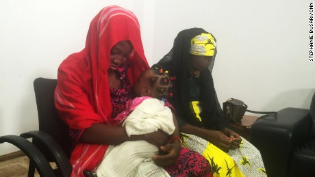 Chibok girl Amina Ali Nkeki (in red), who was kidnapped by Boko Haram, with her baby daughter.