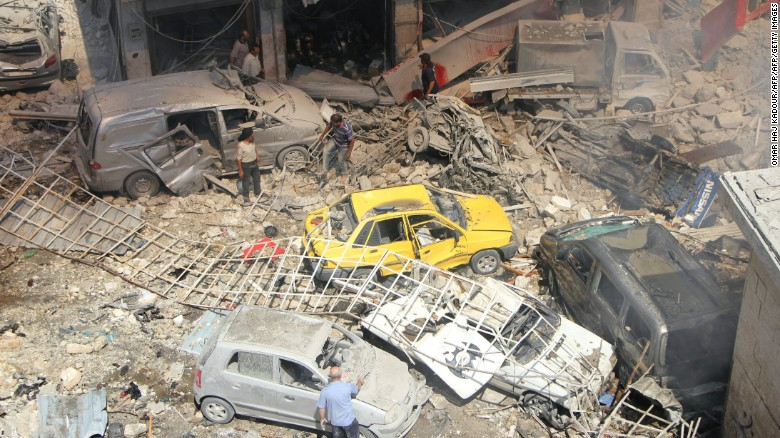 People search for victims at the scene of the airstrikes.