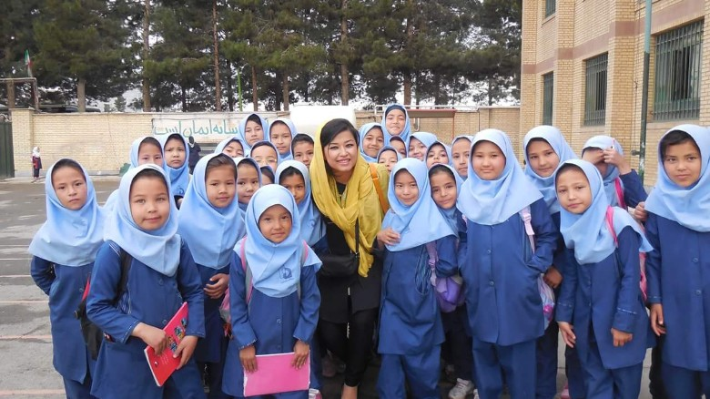 Najeeba Wazefadost with Afghan refugee students in Iran, where she helps with education expenses.