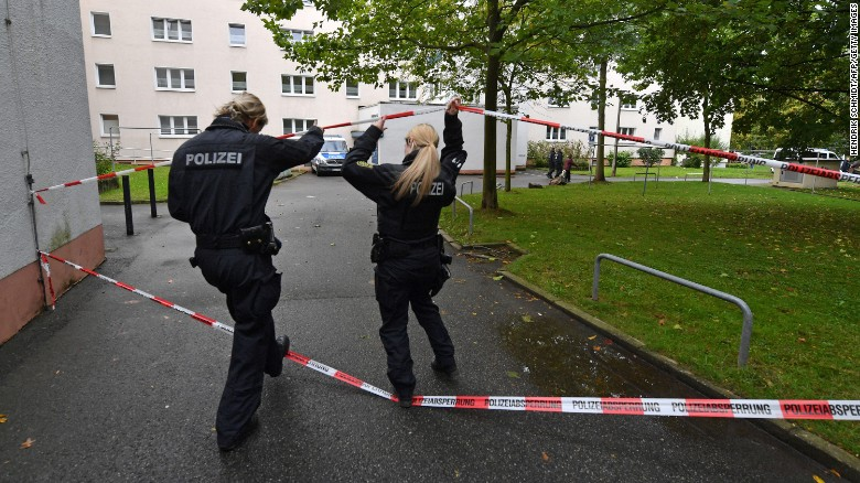 Police secure a residential area in Chemnitz, Germany, after explosives were found in an apartment.