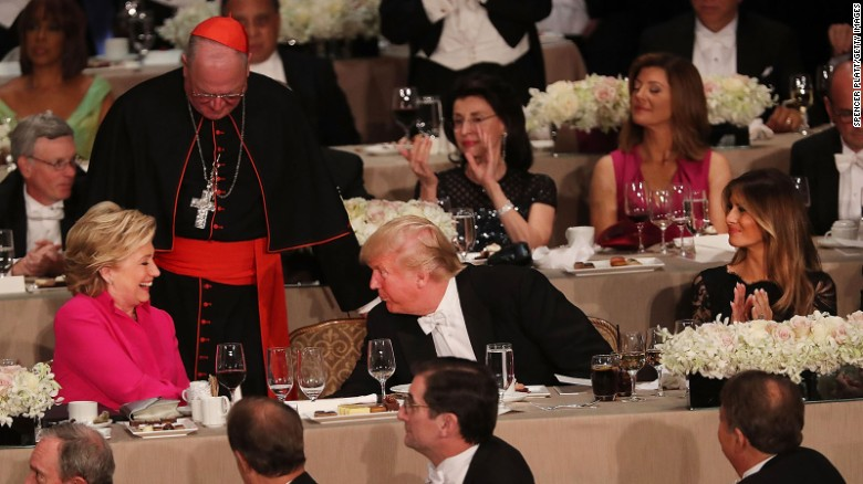 Hillary Clinton speaks briefly with Donald Trump while attending the annual Alfred E. Smith Memorial Foundation Dinner at the Waldorf Astoria on October 20, 2016 in New York City.