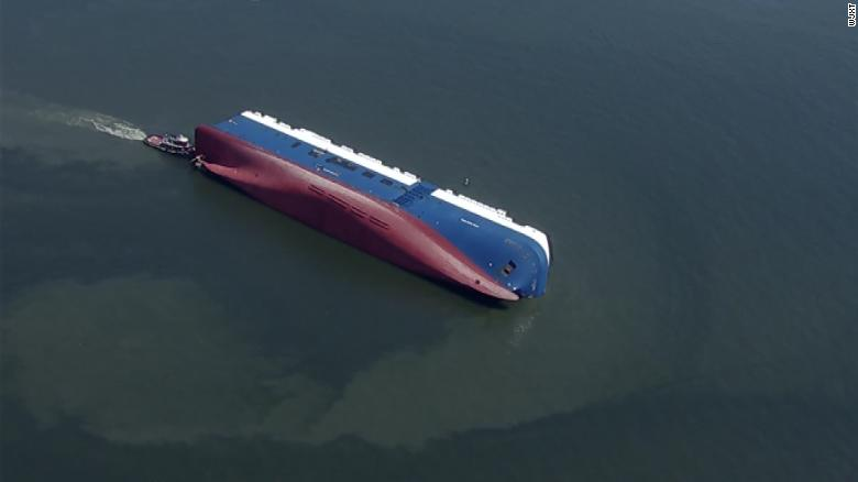 Rescuers pulled 4 trapped men alive from capsized cargo ship
