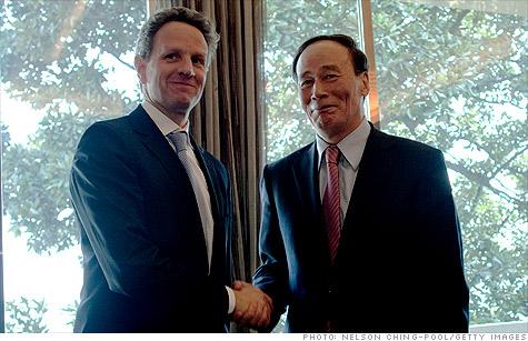 U.S. Treasury Secretary Tim Geithner shakes hands with Wang Qishan, China's vice premier during the G20 seminar in Nanjing, China.