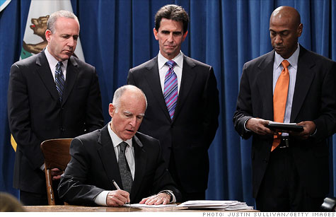 California Governor Jerry Brown signs bills that cut spending by $8.2 billion.